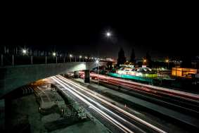 A night view of the bridge that will carry trains over Venice Boulevard.