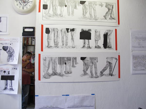 The artist's graphite drawings for the Westwood/Rancho Park Station at his studio during a visit by Metro Art staff.