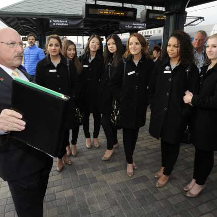 Metro Director of Property Management Ken Pratt leads the Rose Queen and Court to the Gold Line platform. Photo: Juan Ocampo/Metro
