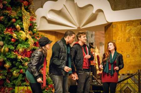 The Tinseltones entertain travelers with a cappella renditions of traditional carols.