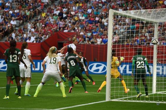 Abby Wambach scores the game-winning header against Nigeria in the cup's first round.