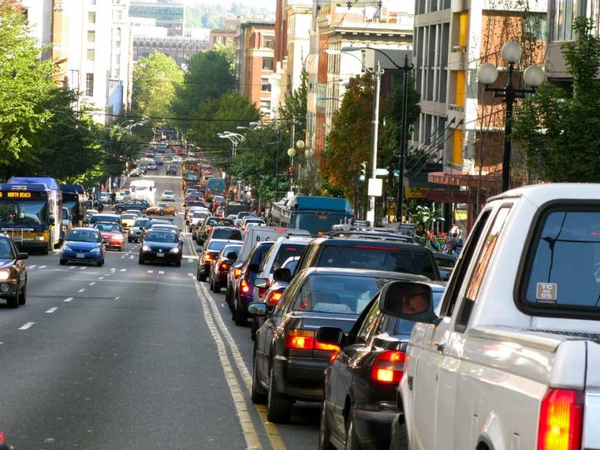Downtown Seattle vs cars. Photo by Oran Viriyincy via Flickr creative commons.