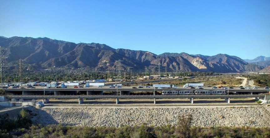 A Gold Line test train crosses the new rail bridge over the San Gabriel River.