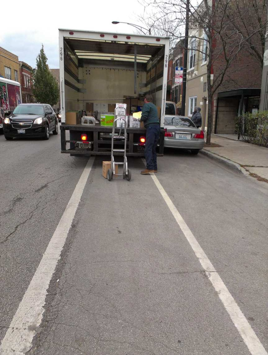 Delivery truck vs bike lane in Chi-town. Photo by get directly down, via Flickr creative commons.
