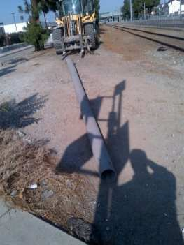 Damaged utility pole removed from the tracks.