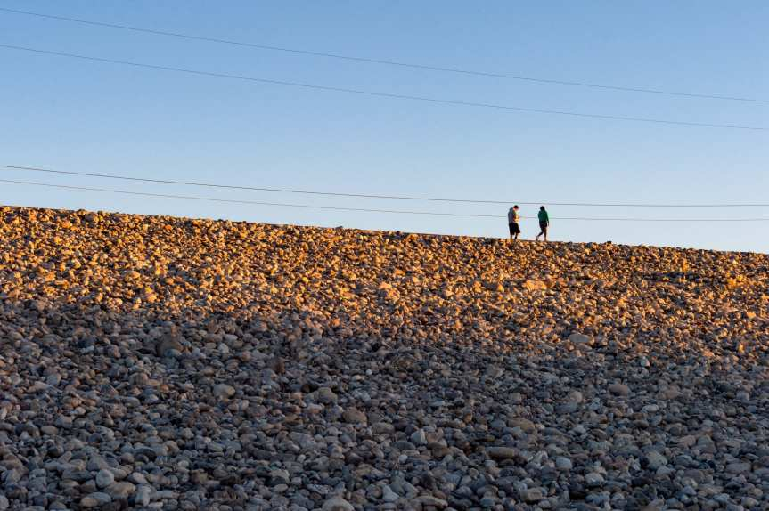 Walkers on the path atop the Santa Fe Dam in Irwindale. Photo by Steve Hymon/Metro.