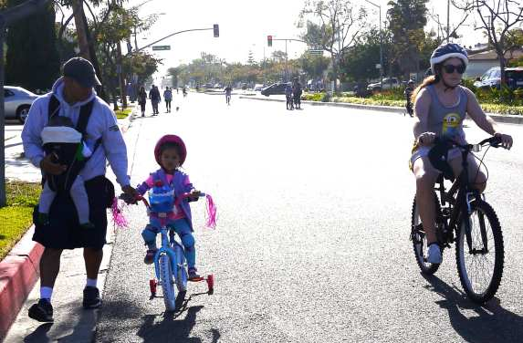 Learning to ride on a safe open street.