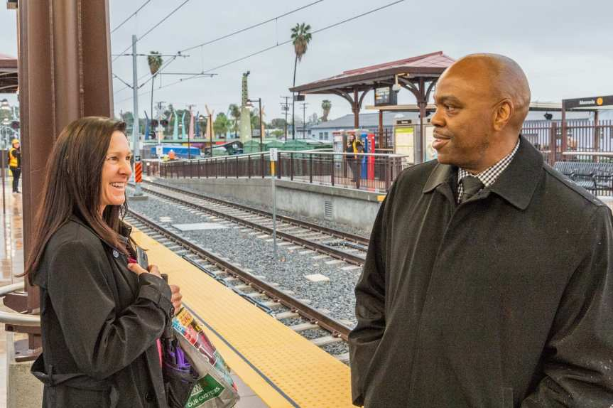 Metro CEO Phil Washington chatting with a customer at the Gold Line's Monrovia Station in March.