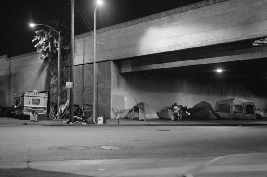 Homeless living under the 110 freeway in the South L.A. on a recent night. Photo by Steve Hymon.