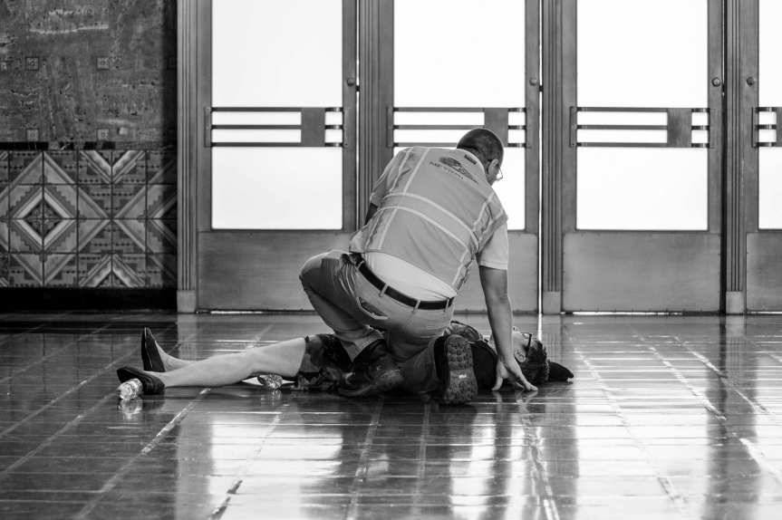 Oh no! Actually, no fear -- this was part of a safety drill this morning in the old ticketing hall in Union Station. This woman was pretending to have a baby to see how station employees and law enforcement would react. Photo by Steve Hymon/Metro.