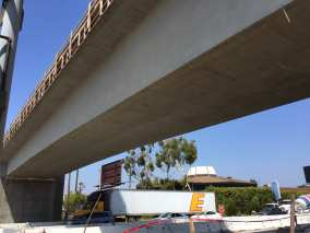 Looking up at the new rail bridge over the 405 freeway.