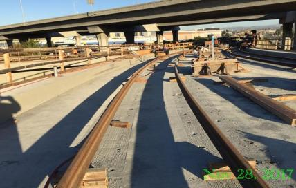 Trains going under 105 freeway en route to junction with the Green Line.