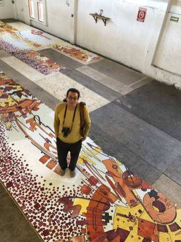 Greenfield and the in-progress mosaic mural, 2019
