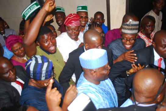 Atiku Abubakar (middle) being cheered by party supporters