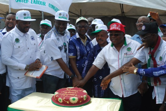 United labour congress members cutting the annivesary cake
