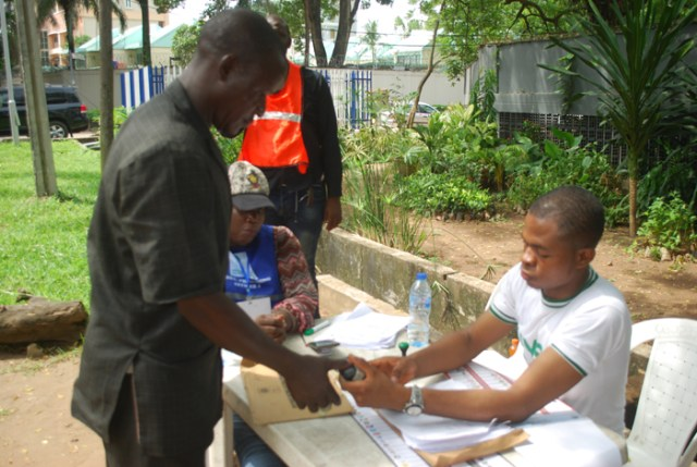 A voter being accredited by INEC official