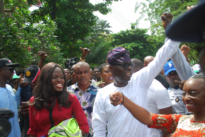 Mr. Babajide Sanwo-Olu recieving cheers from party suporter after casting his vote