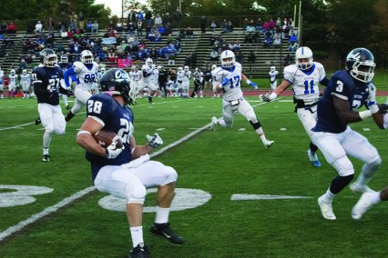 SCSU football team against Assumption College at homecoming game.