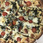 spinach artichoke pizza with white sauce