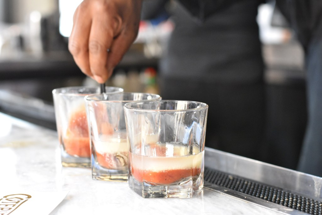 oyster shooters with vodka, hot sauce and horseradish