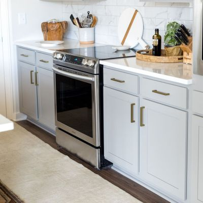 stone gray cabinets with gold brass hardware