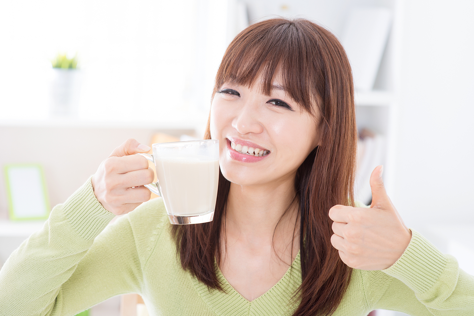 Woman drinking soymilk