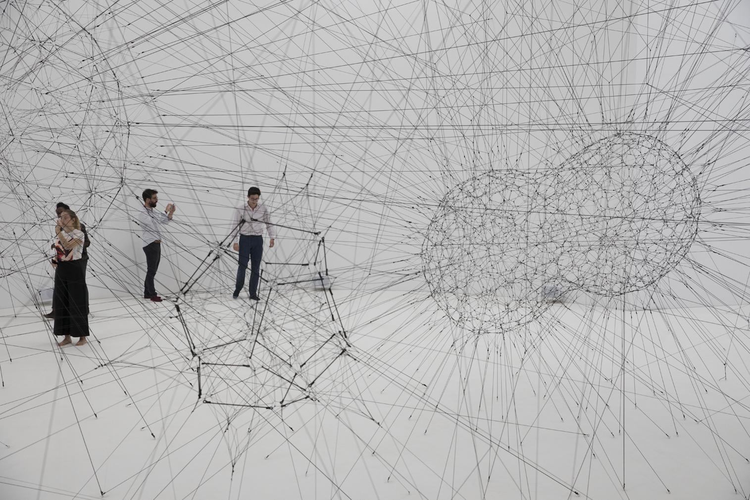 Tomas Saraceno Spins A Cosmic Spiderweb Inside Paris