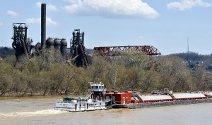 A tug makes it way up the Monongahela River near the furnaces