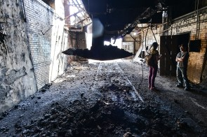 Reporter Amy Kenny interviews Ron Baraff in the coke loading area of the furnace where rail cars were once loaded.