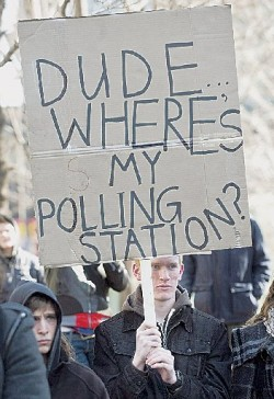 A demonstrator protests the 'Robocall' election fraud scandal, 2012. The Canadian Press