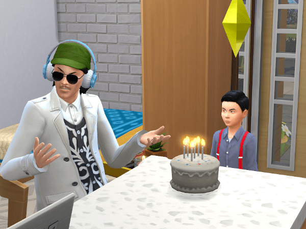 Sims 4 child about to blow out the candles on his birthday cake