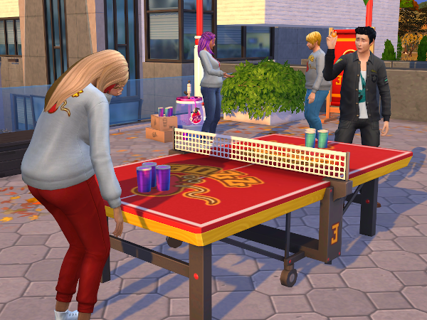 Discover University Sims playing juice pong
