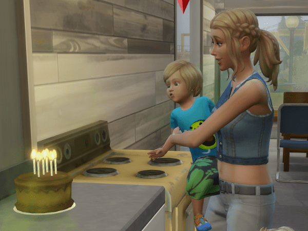 Sim toddler blowing out birthday candles