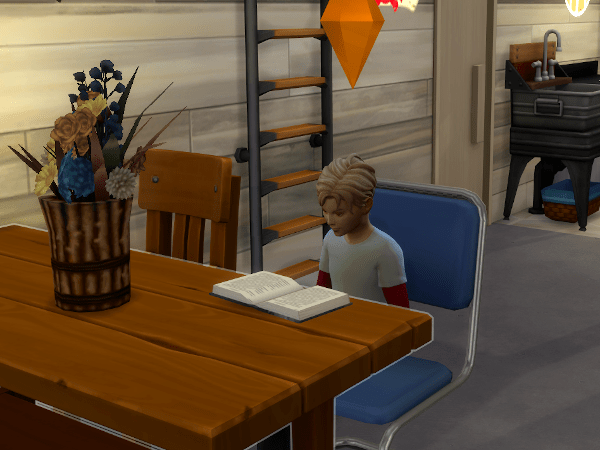 Sims 4 child doing homework at kitchen table off-grid