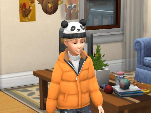 Sim wearing a hat he knit