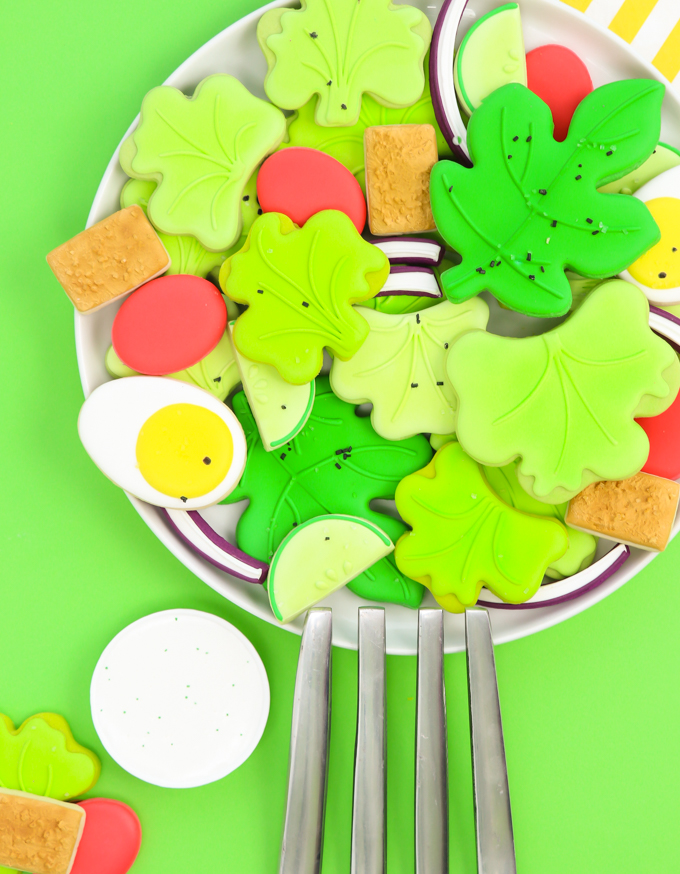 a platter of salad sugar cookies with a giant silver fork