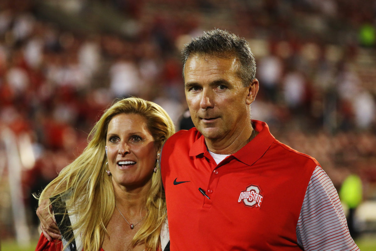 Urban Meyer with his wife after an Ohio State football game.