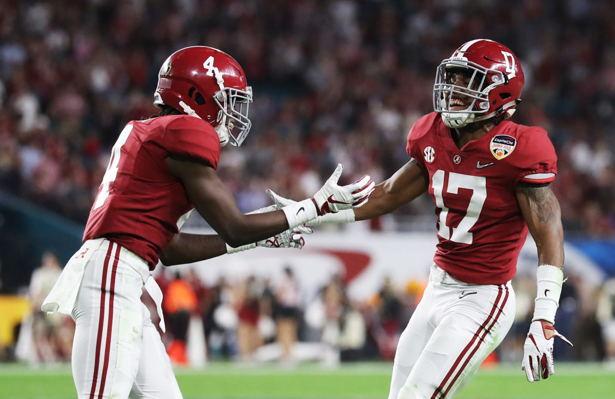 Jaylen Waddle and Jerry Jeudy celebrate a play for Alabama football.