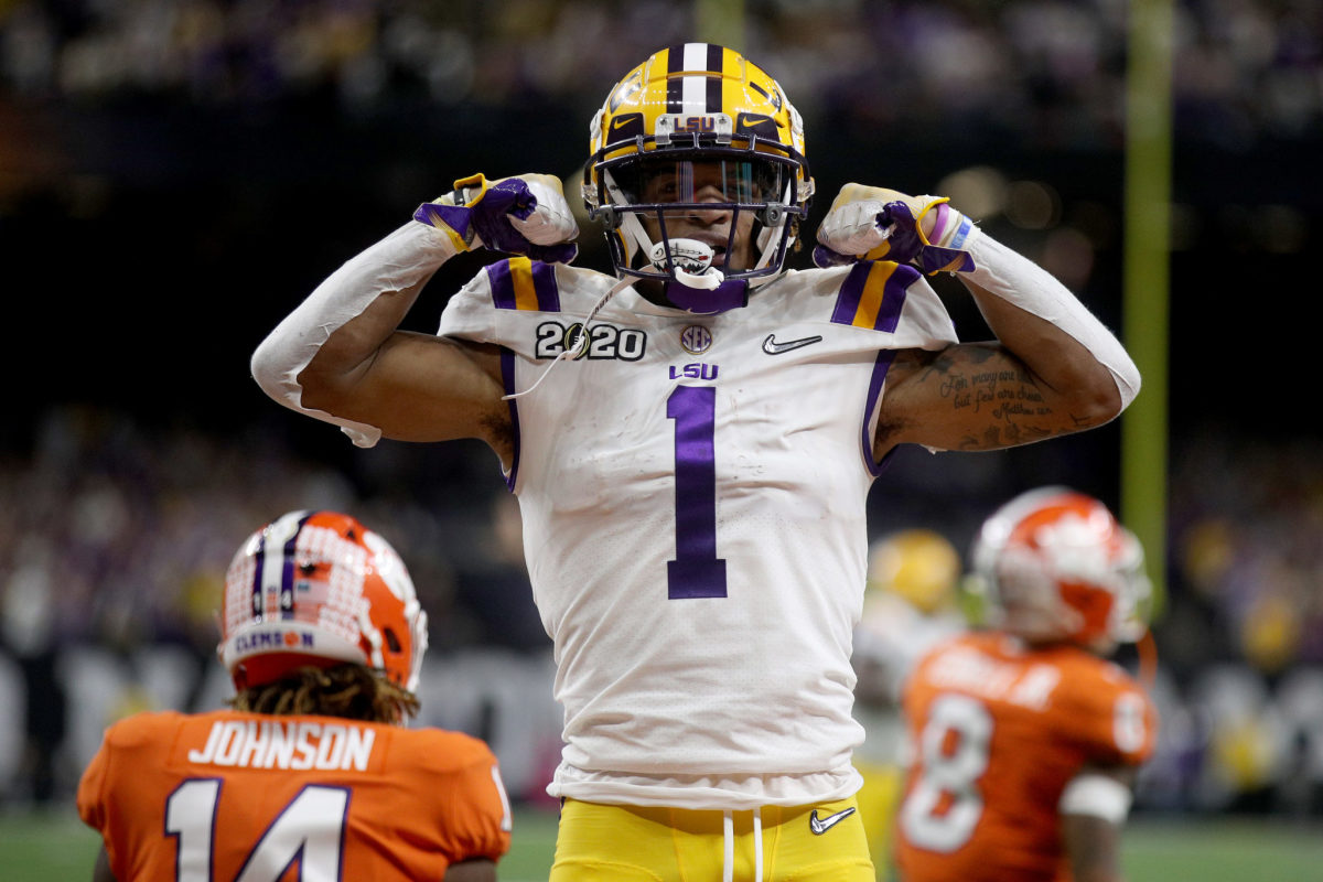 Ja'Marr Chase of the LSU Tigers celebrates on the field.