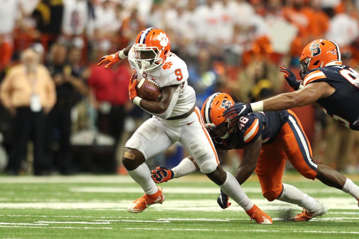 Travis Etienne runs the football for Clemson.
