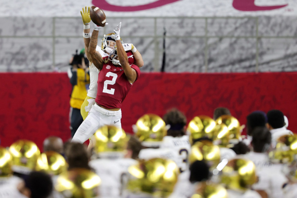 Patrick Surtain goes up for a ball against a Notre Dame receiver.