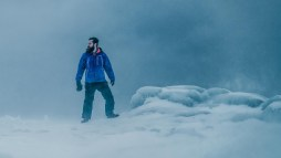 Standing on Lake Superior during a winter storm, facing the wind with my Columbia Omni Heat jacket, and snow pants.