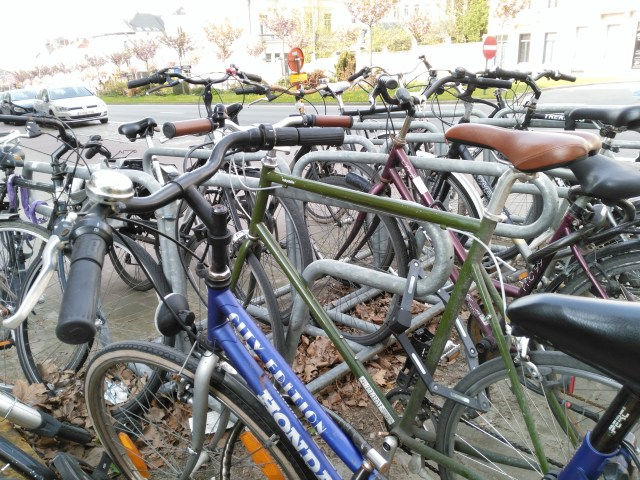 This is a picture of a bunch of parked bikes
