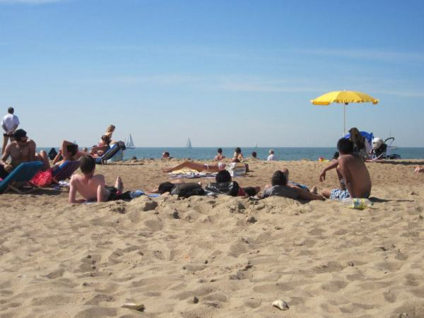This is a picture of people enjoying the beach at the Belgian coast