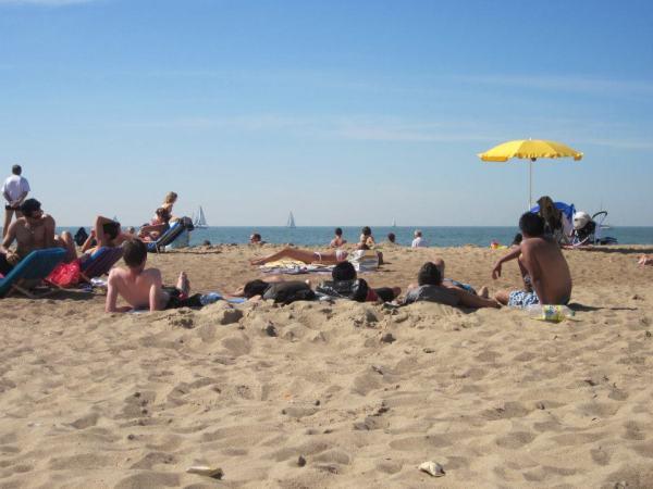People enjoying the beach at the Belgian coast