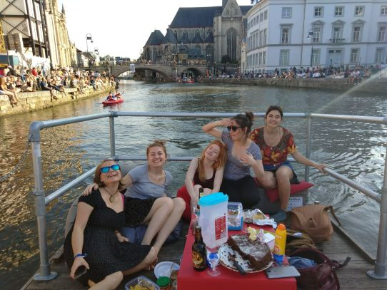 A group of friends on a 'vlot' enjoying one of the best summer things to do on Ghent's rivers