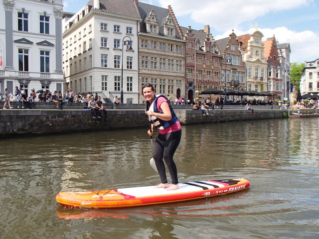 Image of woman stand up paddle boarding in Gent