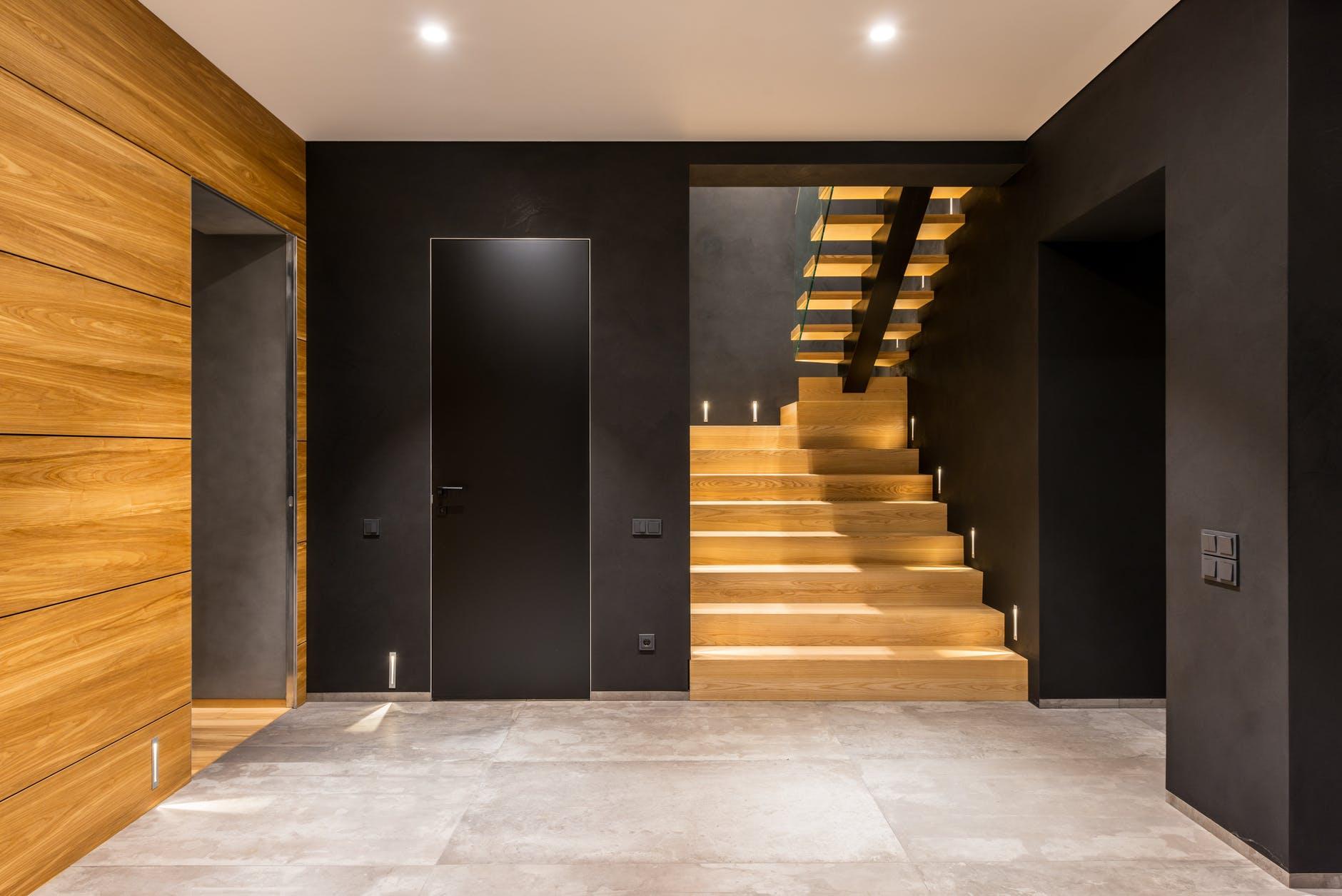 modern spacious corridor with wooden staircase