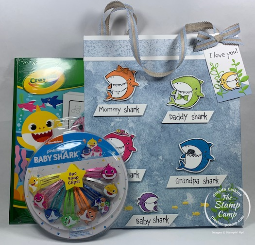 How would you like to create a Baby Shark Gift Bag and Tag to match the gift that is inside? Well today I have just that project for you with this bag and tag featuring the Shark Frenzy stamp set from Stampin' Up! Inside the fun bag is a Baby Shark Coloring Book and Baby Shark Hair clips. #thestampcamp #stampinup #babyshark