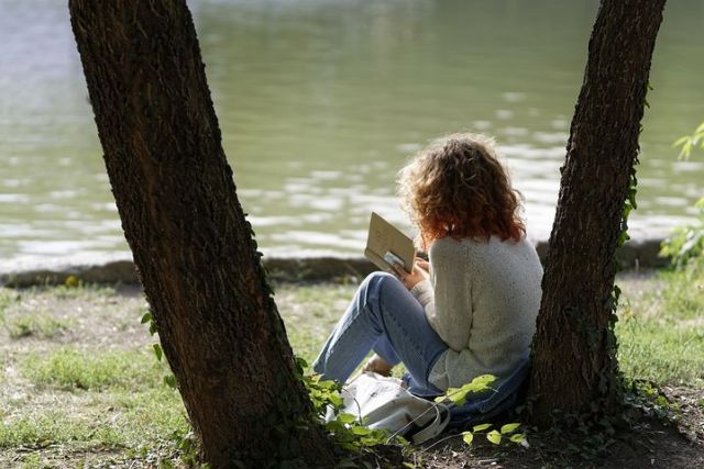 child reading in nature